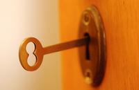 Brass key in keyhole uid