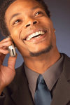 Laughing_businessman_talking_on_cell_pho