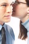 Woman_whispering_secret_into_man_s_ear_u